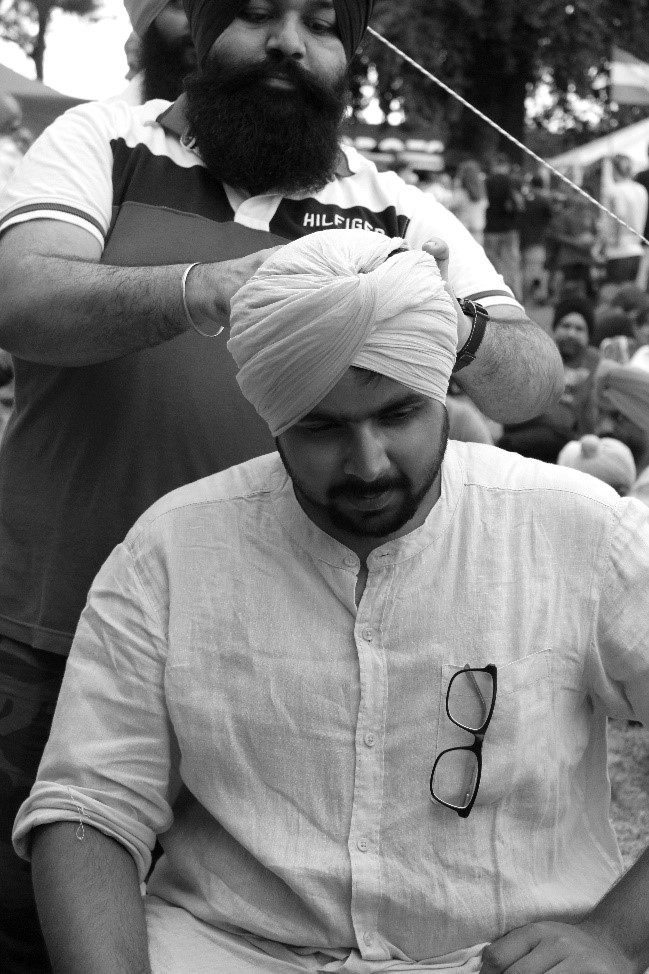 Turban being placed on head